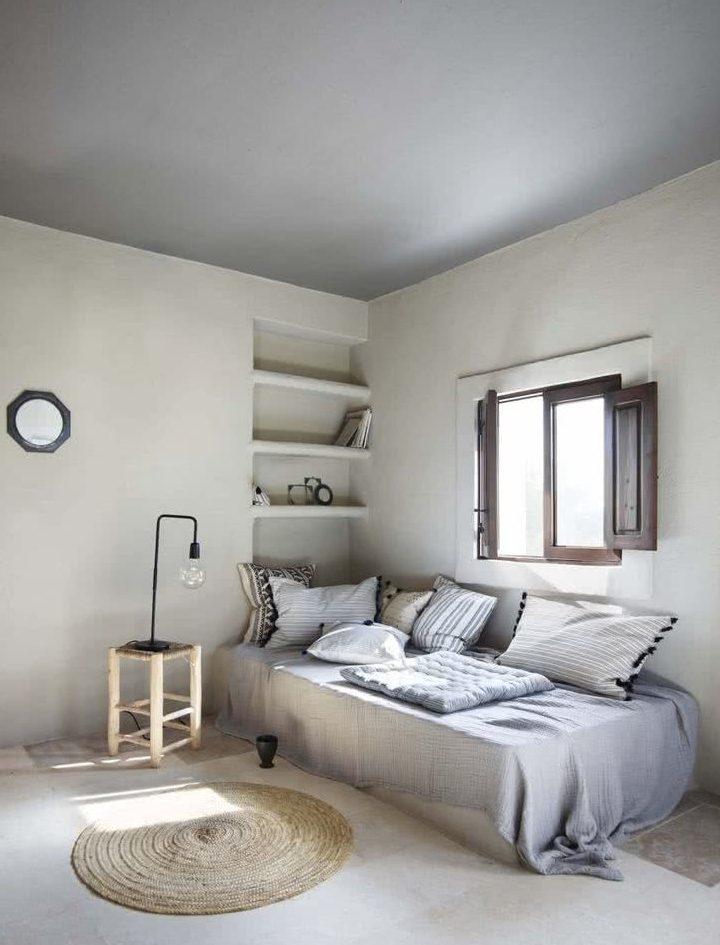 decoración con cojines en el dormitorio